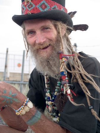 grey: Happy older gentleman with a top hat and dreadlocks