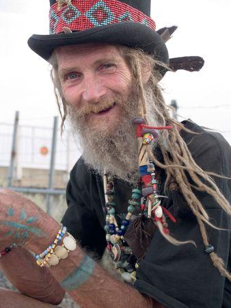 Happy older gentleman with a top hat and dreadlocks