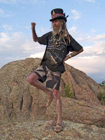 body paint: Active, flirty eccentric older gentleman with dreadlocks, body paint and a top hat