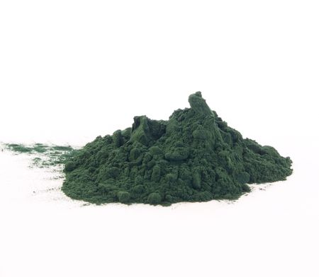 Spirulina powder isolated on white.