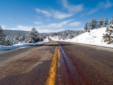 State road 64 to Tierra Amarilla, New Mexico, in winter photo