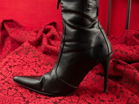 Sexy black high heel boot on red Stock Photo - 5812954