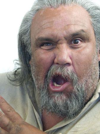 Big Latino man making a very strange face