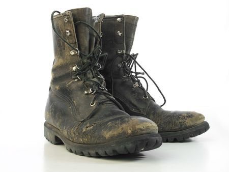 combat boots: Worn old combat boots isolated on white Stock Photo