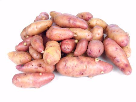 fingerling: Garden fresh rose fingerling potatoes isolated on white Stock Photo