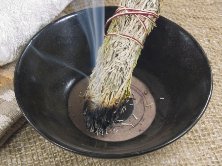 Traditional Native American Artemisia smudge stick burning