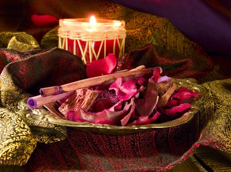 Red candle with red potpourri  photo