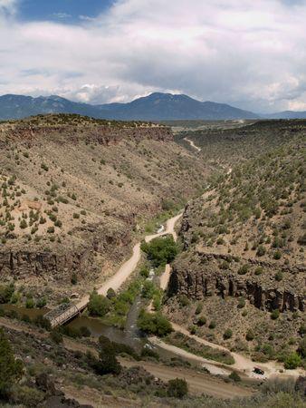 hondo: John Dunn Bridge in Rio Grande Gorge where Rio Hondo runs into the Rio Grande. A popular hiking, swimming and fishing spot. In the background Sangre de Cristo mountains, part of the Rocky Mountains. Taos County, New Mexico.