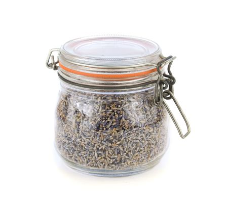 airtight: Dried lavender flowers stored in an airtight glass jar isolated on white