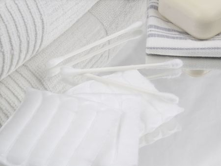 swaps: White cotton towel with a soap and a wash cloth cotton squares and swaps. Stock Photo