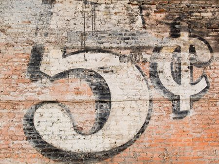five cents: Grunge red brick wall background