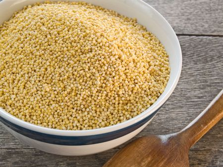 Millet, a gluten-free healthy grain. Also called pearl millet. Stock Photo - 6125325
