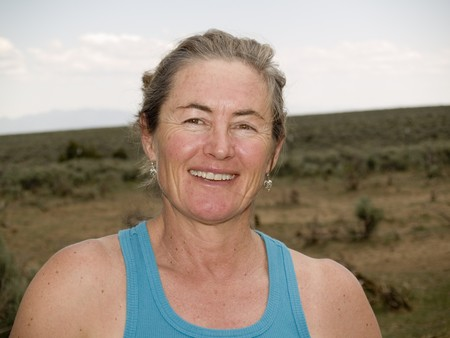 late 40s: Athletic, healthy and happy woman in her late 40s outdoors in nature