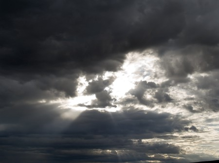 unpredictable: Stormy clouds and rays of sun Stock Photo