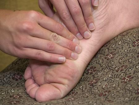 Massage therapist giving a foot massage. photo