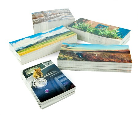 copyrights: Stacks of new postcards isolated on white. The cards are my production, I own copyrights to all the postcard images, no copyright infringement issues.