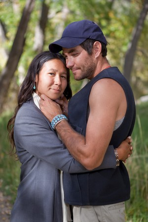 native american girl: Happy young couple in fall forest
