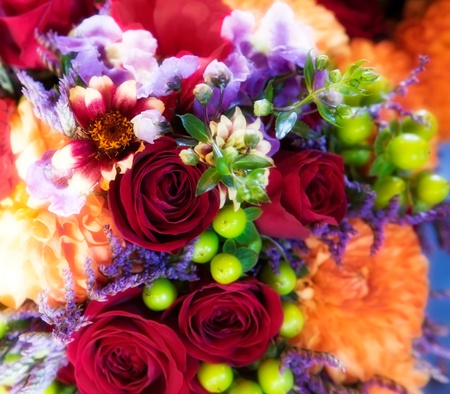 Colorful bouquet with red roses, chrysanthemums and orchids