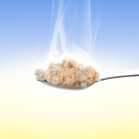 spoonful: Spoonful of hot oatmeal for breakfast