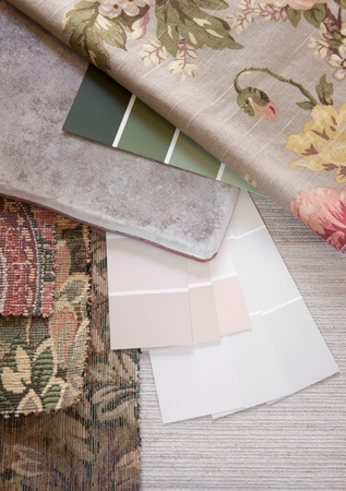 Floral and pastel paint color and fabric swatches with a floor tile photo