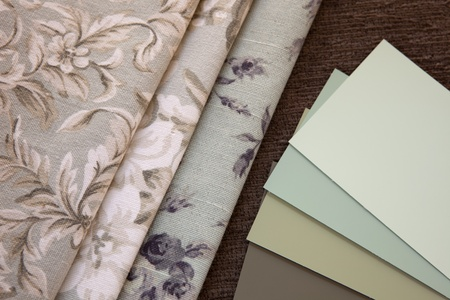 Light green subdued paint color and fabric swatches, floral pattern interior design. Stock fotó