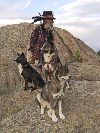 animal lover: Exc�ntrico amante de los animales con sus perros Foto de archivo