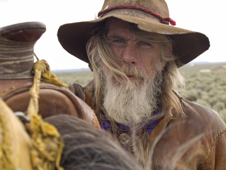 Rugged cowboy whisked by the wind  photo