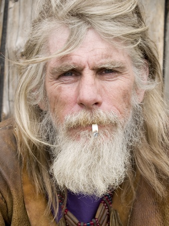 long beard: An old cowboy without his hat