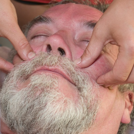 Man in his 50s getting a facial massage photo