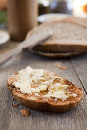 Brie cheese on a hot toast, whole wheat bread, for snack. Shallow DOF. Stock Photo