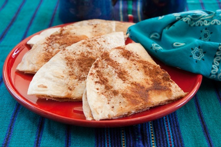 tortillas: Sweet tortillas with cinnamon for dessert in a colorful setting