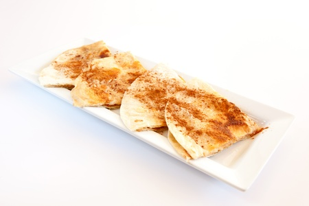 tortillas: Sweet tortillas with cinnamon for dessert on white background. Stock Photo