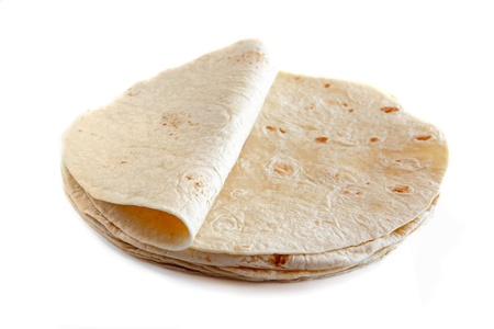 Witte tarwe tortilla's op een witte achtergrond Stockfoto
