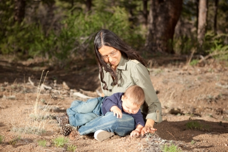 native american baby: Mother and baby boy studying things in nature