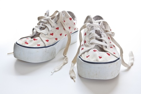 Red hearts on white sneakers for Valentine photo