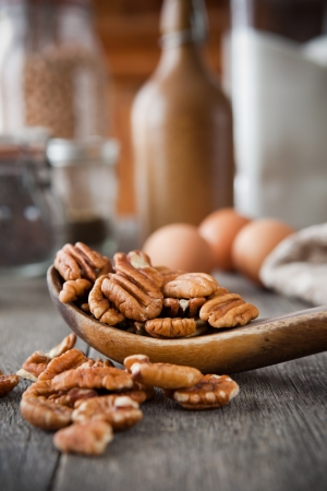 whole pecans: Pecans in a wooden spoon Stock Photo