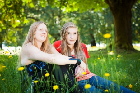 dof: Mother and daughter in green summer nature  Shallow DOF, girl