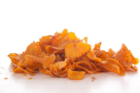 Sweet potato chips on white background photo