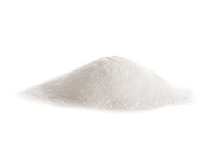 heap: Vitamin C powder, ascorbic acid on white background