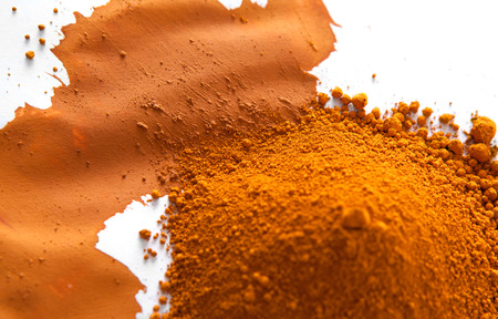 Mineral: Ochre, also spelled ocher, a natural yellow earth pigment based on hydrated iron oxide.