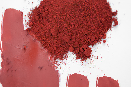 dye powder: Red ochre, also spelled ocher, a natural red earth pigment based on hydrated iron oxide. Stock Photo