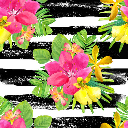 tropical plants: Beautiful bouquet with tropical plants on a striped black and white background. Composition with lily, palm leaves and orchid. Stock Photo