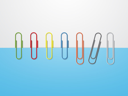 index card: Colorful paper clips on blue paper
