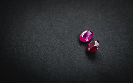 Red ruby, Precious stones for jewellery on black matte paper background, rough paper Stock Photo