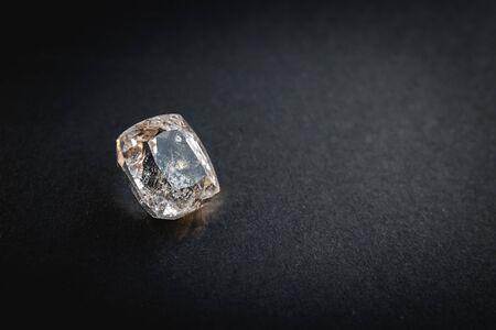 White topaz, Precious stones for jewellery on black matte paper background, rough paper