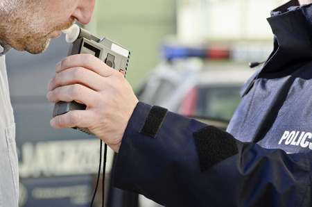 drunk: photo depicting clinical tests trzezewosci state driver by a policeman