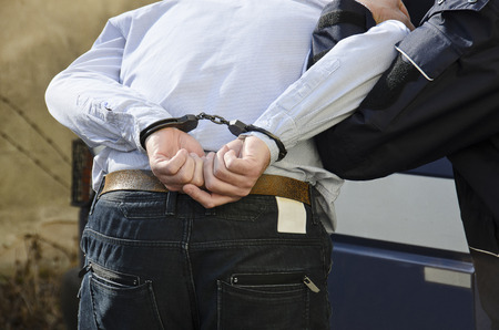 The photo shows the arrest of a man  photo