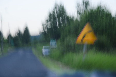 Photo shows a blurred vision while driving after drinking alcohol.