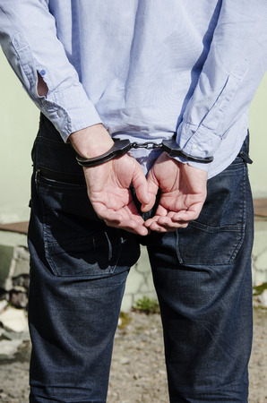 felony: Photo of man in handcuffs. Stock Photo