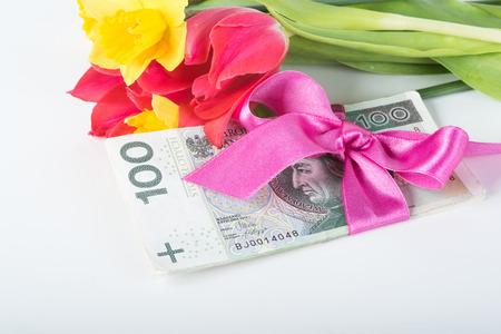 christmas debt: Stack Polish banknotes associated with a pink ribbon